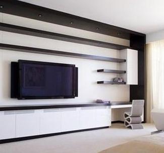 白色墙面做底,黑色的隔板设计,一个简单的电视背景墙设计成功了.